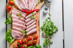 Smoked cold cuts with pepper and herbs Stock Photos