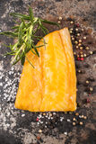 Smoked coley with rosemary, peppercorn and salt Royalty Free Stock Image