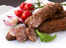 Smoked dried sausage with tomato and greens Royalty Free Stock Image