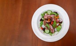 Smoked duck breast rocket salad orange balsamic vinaigrette in w Royalty Free Stock Image