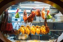 Smoked duck, chicken and meat are exposed on the kitchen's window royalty free stock photo