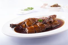 Smoked duck with soya sauce on dish stock photography