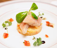 Smoked eel dish on plate Stock Image