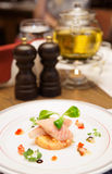 Smoked eel dish on table Royalty Free Stock Photos