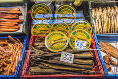 Smoked eel and fish in retail fridge Stock Images