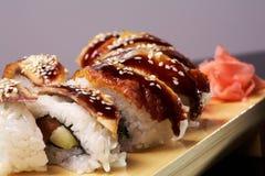 Smoked Eel Roll unagi made of Fresh Raw Salmon Stock Photos