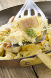 Smoked eel with scrambled eggs Stock Images