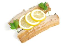 Smoked fillet of herring. On a white background Stock Photos