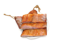 Smoked fish. Pieces smoked fish on a white background Stock Photography