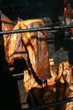 Smoked fish. Smokehouse fish - smoked fish smoke - halibut and cod Royalty Free Stock Photography