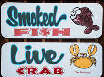 Smoked Fish anf Live Crab restaurant sign Royalty Free Stock Images