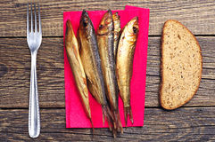 Smoked fish on board Stock Photo