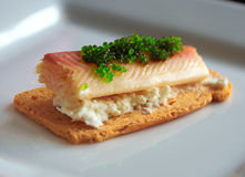 Smoked fish canape. A small toast with ricotta cheese, smoked trout and flying fish roe wasabi flavor (Tobiko caviar Stock Images