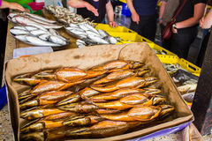Smoked fish in different sizes laying on a table Stock Image