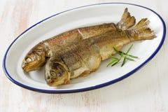 Smoked fish on dish Royalty Free Stock Photography
