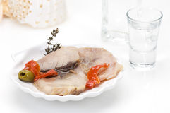 Smoked fish fillet and ouzo Royalty Free Stock Photo