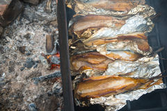 Smoked fish on fire Royalty Free Stock Images