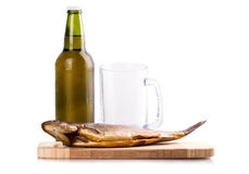 Smoked fish glass bottle beer Royalty Free Stock Photos