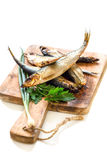 Smoked fish, green onions and parsley. Stock Photography