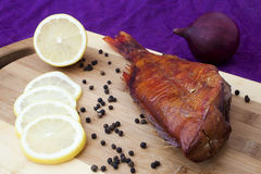 Smoked fish on the kitchen board Royalty Free Stock Photography