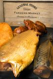 Smoked fish, mackerel, sig, perch and cod roe on the black wooden table Royalty Free Stock Photo