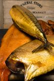 Smoked fish, mackerel, sig, perch and cod roe on the black wooden table Stock Photo