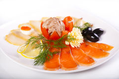Smoked fish with olives and Lemon. Stock Image