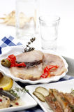 Smoked fish and ouzo Stock Photography