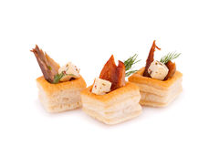 Smoked fish in pastries. Smoked fish  and feta cheese in pastries isolated on white background Stock Photography