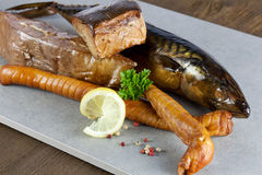 Smoked fish. With pepper and lemon Stock Photo