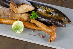 Smoked fish. With pepper and lemon Stock Image