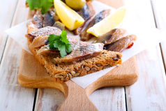 Smoked fish pieces on brown seed bread Royalty Free Stock Photography