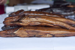 Smoked fish. Pike close up on the table Royalty Free Stock Photo