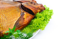 Smoked fish on plate close up Royalty Free Stock Photo