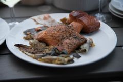 Smoked fish on a plate. Delicious norwegian food fish on a table Royalty Free Stock Image