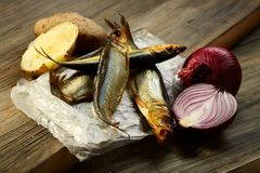 Smoked fish, potatoes and red onion. Royalty Free Stock Images