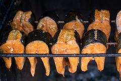 Smoked fish - salmon. Smoked fresh fish - smoked salmon Royalty Free Stock Photo