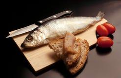Smoked fish: salted and seasoned herring stock photography