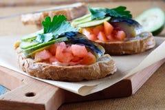 Smoked fish sandwich mackerel tomato feihua paprika cheese royalty free stock photos