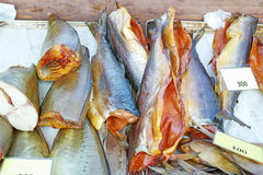 Smoked fish on a shop counter Royalty Free Stock Images