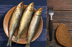 Smoked fish on table Royalty Free Stock Image