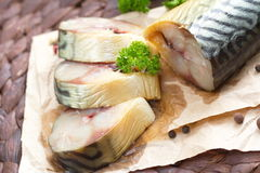 Smoked fish with vegetables and spices Stock Images