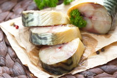 Smoked fish with vegetables and spices Royalty Free Stock Photography