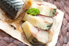 Smoked fish with vegetables and spices Royalty Free Stock Image