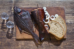 Smoked fish and vodka Royalty Free Stock Photography