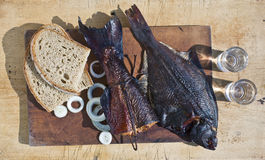 Smoked fish and vodka Royalty Free Stock Photos