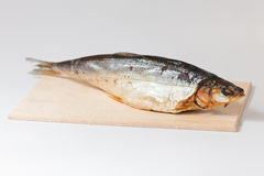 Smoked fish. On wooden board. Whitefish Stock Photo