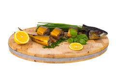 Smoked fish on wooden cutting board Stock Photo