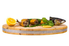 Smoked fish on wooden cutting board Royalty Free Stock Photo