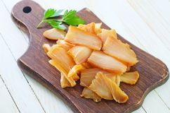 Smoked fish. On wooden plate royalty free stock photography